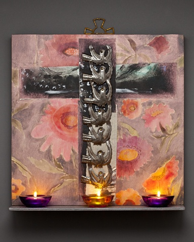 Wood panel painting with shelf holding votive candles