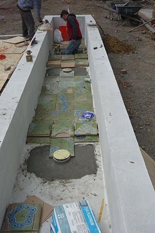Floor tiles going in...