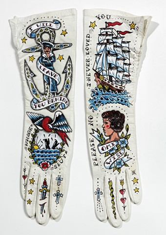 tattoo on vintage gloves with anchor, clippership, and sailor motif