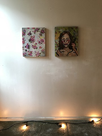 two paintings with lights