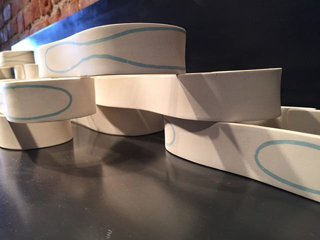 Ceramic forms with inlayed slip, and stacked. A study in water movement.