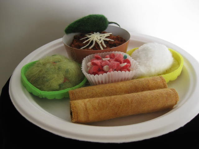 """Tex-Mex Combo Plate #7"" is a felted mixed media piece of contemporary fiber art by Linda Thiemann."