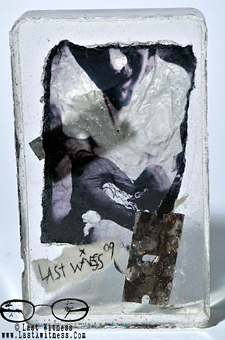 photo emulsion suspended in resin with rusted single edge razor blades