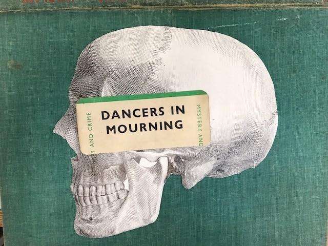 dancers in mourning skull