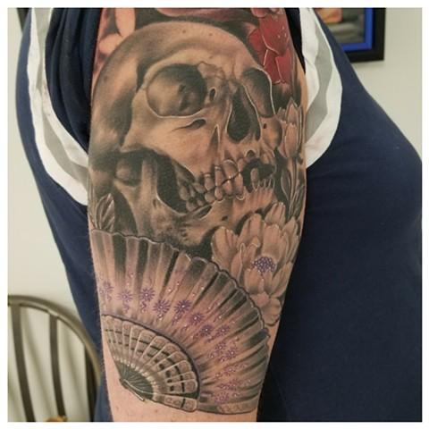 skull and fan