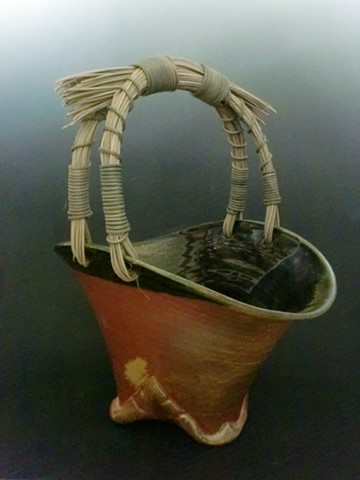 Large Wood fired Basket with Altered Foot and Rattan Handle