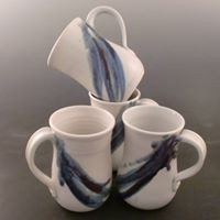 Mugs, new glaze design, clear base with blues and purples.
