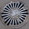Water Grate With Reflection - Lower Manhattan, NYC