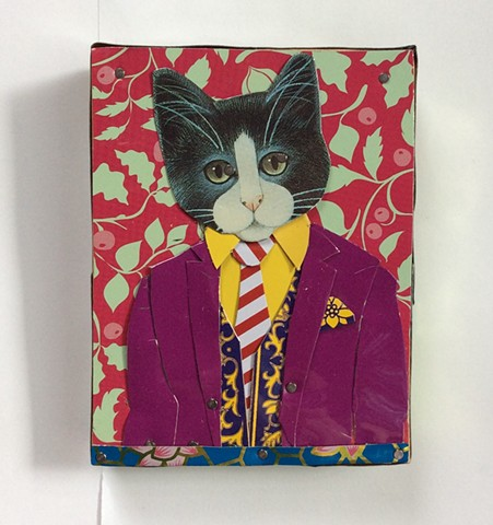 Tin artwork of a Tuxedo Cat in a suit and tie