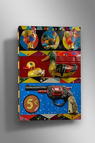 Vintage toys and lithographed tin are assembled to create the look of an old shooting gallery
