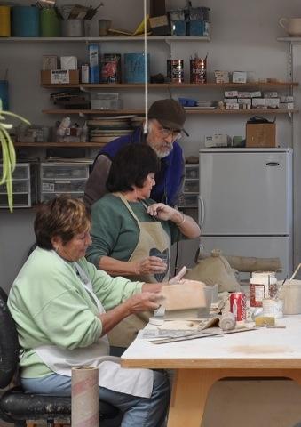 Students working on raku pieces