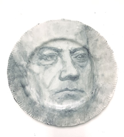 Onglaze portrait painting on a second hand ceramic plate based on a family photograph.