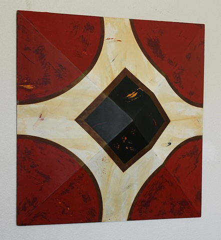 """Black and white pattern on vivid red background on pyramid-shaped square that is 4"""" at its deepest point."""