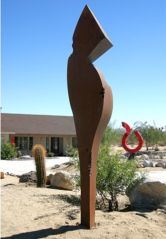 large outdoor steel sculpture with rusted brown patina