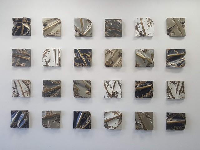Twenty four individual one-foot squares, each piece unique.