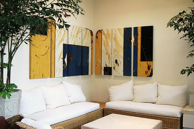 Squares of blue, yellow ocher and black on an ivory background on this huge corner metal grouping of seven pieces fill the space beautifully.