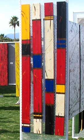 Bands of primary colors with black and ivory-stained white on steel.
