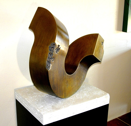 Pedestal bronze sculpture with golden patina that rocks at the slightest touch. On travertine base and steel pedestal.