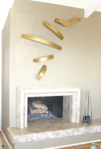 Beautiful five piece bronze with light gold patina that moves in and out of the wall, up and across the wall. It is in a private collection in California.