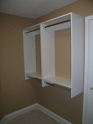 White melamine double hang cabinetry