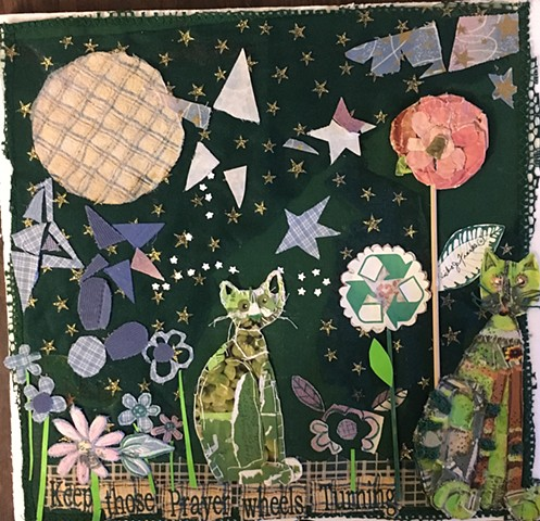 This is a collage assembled on packing foam. Paper and scrapes of cloth are glued and stitched onto a green table napkin.omposition.