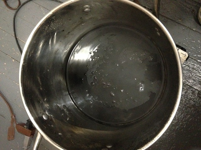The husks are strained out and the liquid is brought back to a simmer for a while longer.