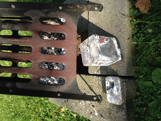 Tins of charcoal removed from the fire (Altoid and tea tins are good sizes for making charcoal.)