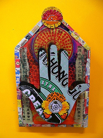Tin hand on collaged board