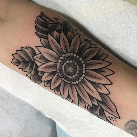 Floral sunflower made in a traditional tattoo style in Toronto Ontario Canada