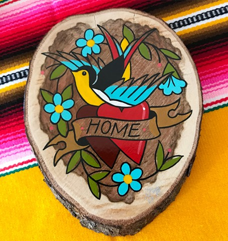 Traditional swallow or sparrow bird painting in a bright and bold tattoo style on wood