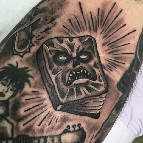 Evil Dead Necronomicon book, traditional black and grey style mini horror tattoo. Made in Toronto