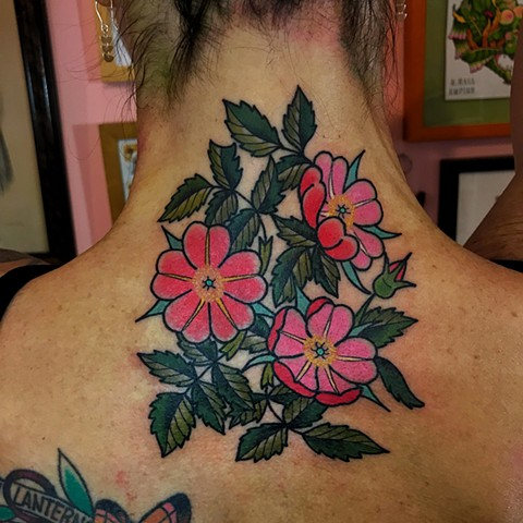 Colourful bright pink colour traditional or neo-traditional tattoo in feminine style back of neck with detail made by Jenny Boulger in Toronto Canada