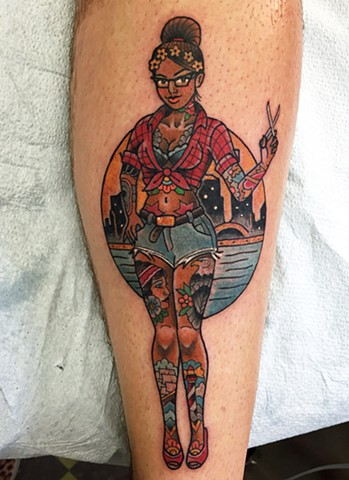 Tattooed pinup girl tattoo of a hair dresser in Toronto. Neotraditional or traditional style in bold colour.