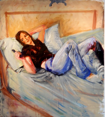 Woman on a bed holding a gun
