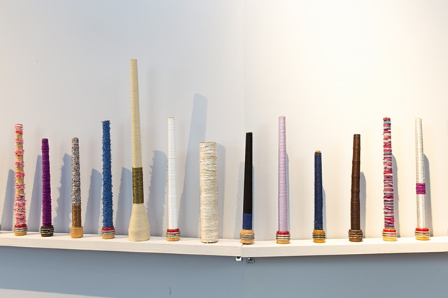 wooden bobbins wound with string