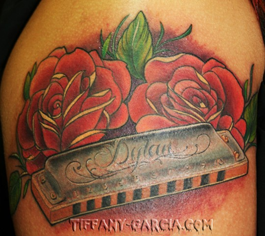 Roses and Harmonica  by Tiffany Garcia Female Tattoo Artist located in Long Beach, Orange County, LA, Huntington Beach, Carson, Palos Verdes, Los Angeles, West Hollywood, Pacific Coast Highway and surrounding areas in Southern California.