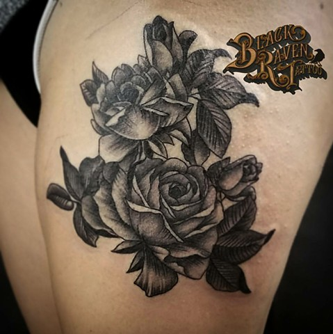 black and grey flowers on thigh by artist Tiffany Garcia Torrance