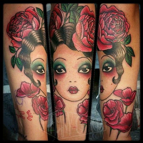 Modified Angelique design traditional tattoo done by female Tattoo Artist Tiffany Garcia