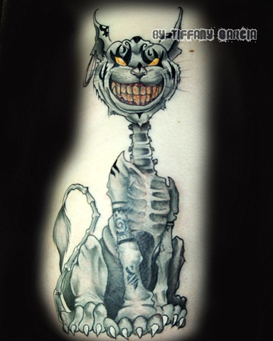 American McGee's Cheshire Cat by Tiffany Garcia Tattoo Artist Custom Tattoos by Tiffany Garcia Tattoo Artist located in Long Beach, Huntington Beach, Carson, Palos Verdes, Los Angeles, West Hollywood, Pacific Coast Highway and surrounding areas in Souther