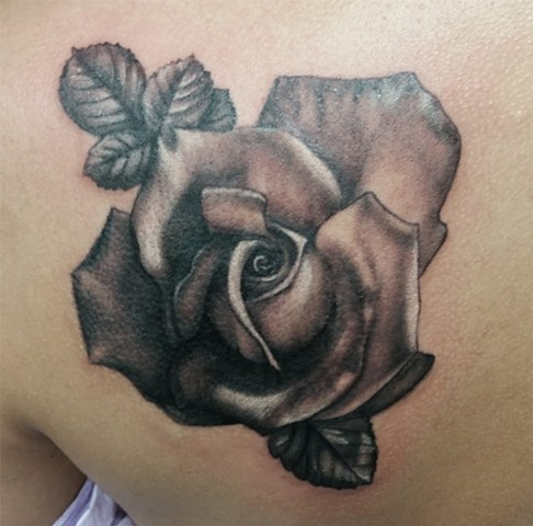 Black and grey rose done by Female artist Tiffany Garcia In Long Beach, CA