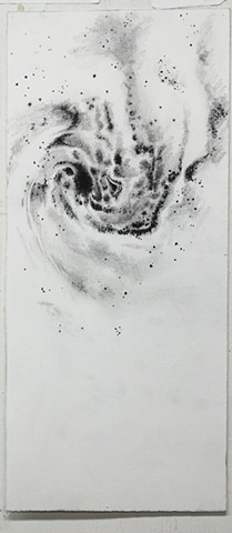 miniature galaxy drawing with charcoal and ink