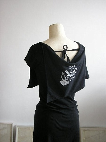 the songbird capelet dress.