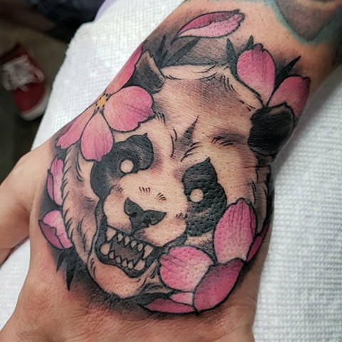 Panda bear hand tattoo