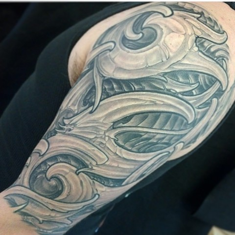 Black and grey biomechanical tattoo half sleeve