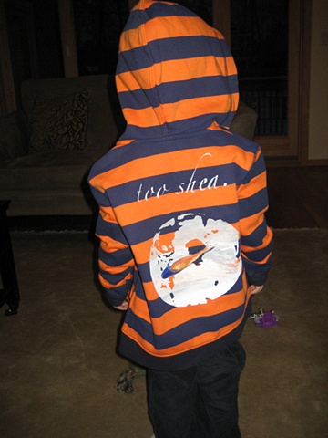 "Aiden in a custom ""too shea"" hoodie."