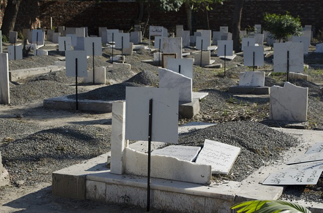 Ahmaddiya community which is persecuted in Pakistan. By law they cannot declare themselves as Muslims or take Allah's name. Here 'miscreants' broke their marble tombstones because they bore Quranic versus. These were quickly being replaced by tin plaques