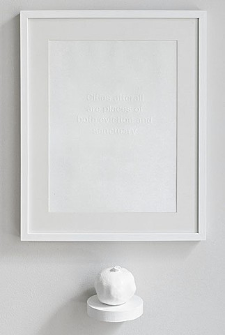 embossed print with round white shelf and pomegranate