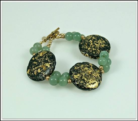 "Jade and gold Bracelet, gilded jewelry, gold gilded bracelet, Jade, Gold, ""A Round in Jade"" Bracelet in 23-Karat Gold Leaf on Lava Stone and Jade by Jan Maitland, janmaitland.com, Jan Maitland jewelry designs"