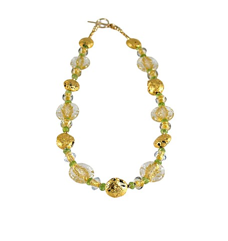 Crystal Glow Peridot and Gold Necklace, Hand gilded 23-Karat gold leaf on lava, peridot and gold necklace, Czech Glass, pyrite, and 23-karat gold-filled toggle clasp with the artist's signature tag. The necklace measures 18.5""