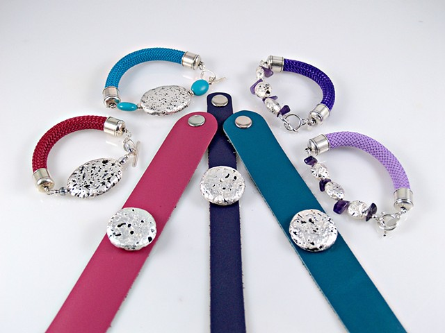 "Signature gilded stone bracelets in colorful braided cord and leather. (""Vino"", ""Blue Popsicle"", ""Grape Vine"", ""Soft Lilac"")"